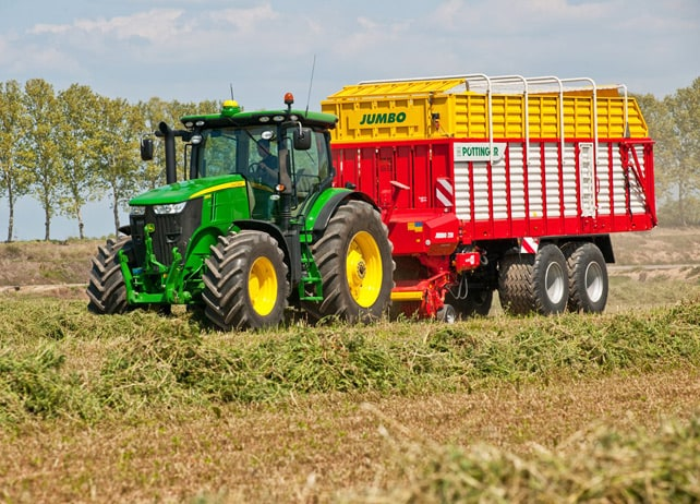 AMS: John Deere tractor with loader in field